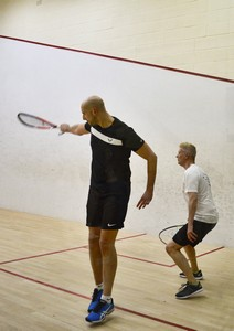 two men playing racketball or squash fifty seven